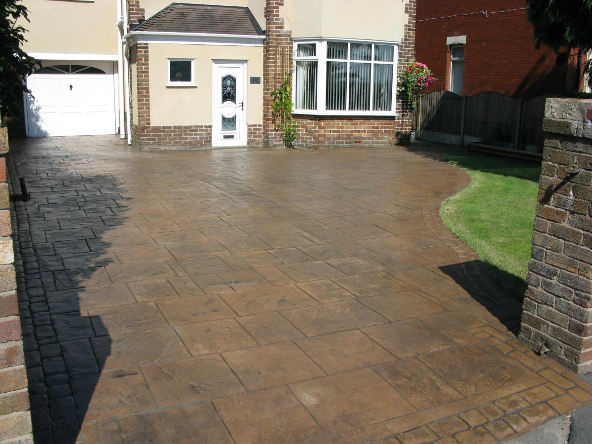 Decorative concrete driveway in toffee coloured walkway slate with a satin finish at a property in Poulton-le-Fylde.