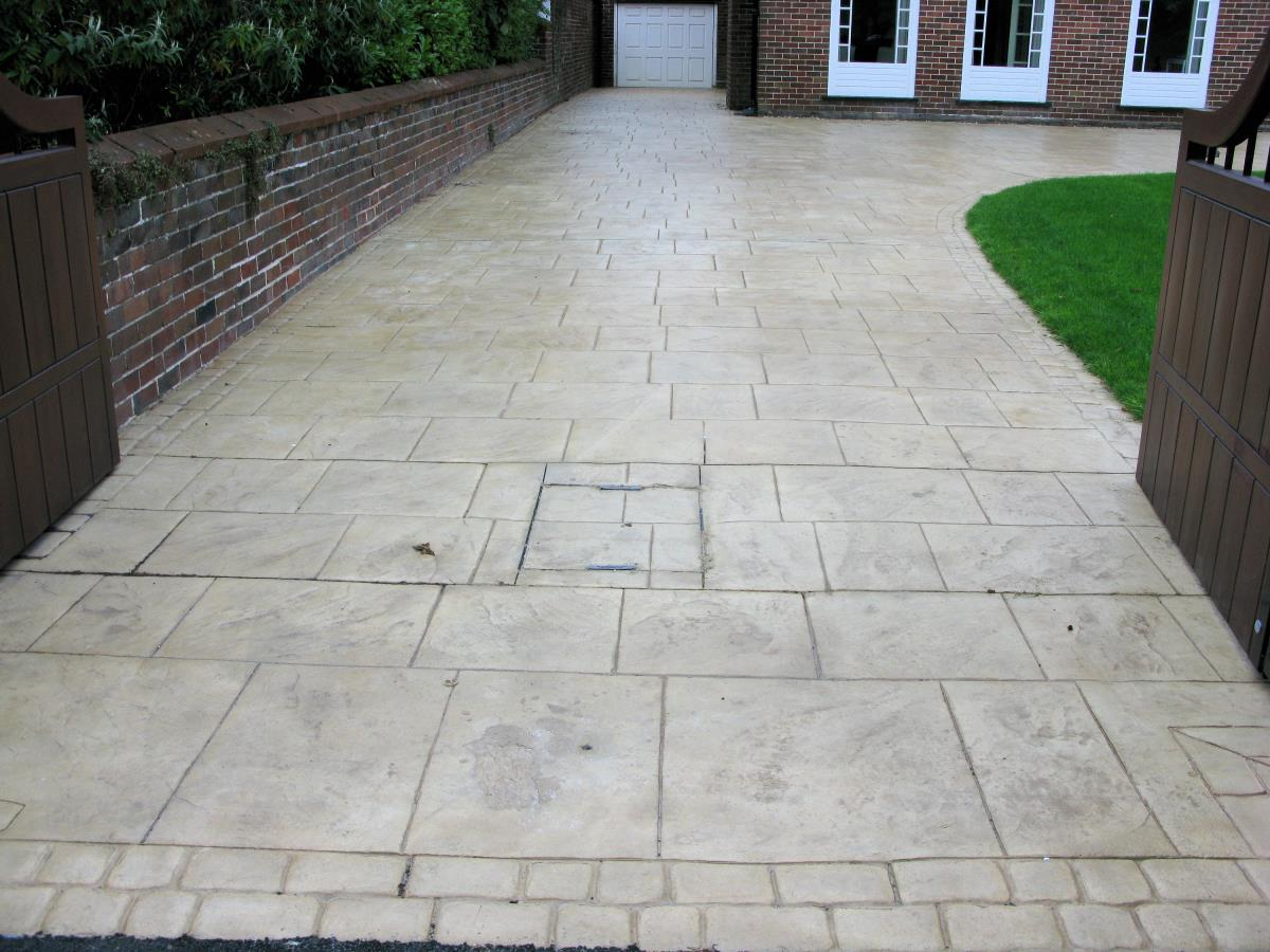 Pattern imprinted concrete driveway stamped to resemble stone flags with mews cobblestone edging for household in Blackpool.