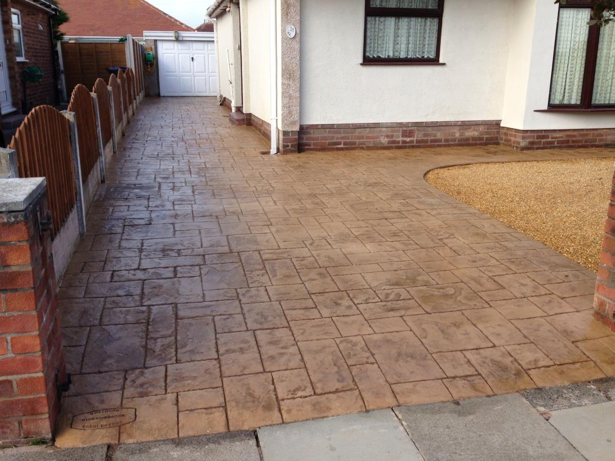 Ashlar slate style stamped concrete driveway in light buff installed to a Poulton-le-Fylde bungalow.