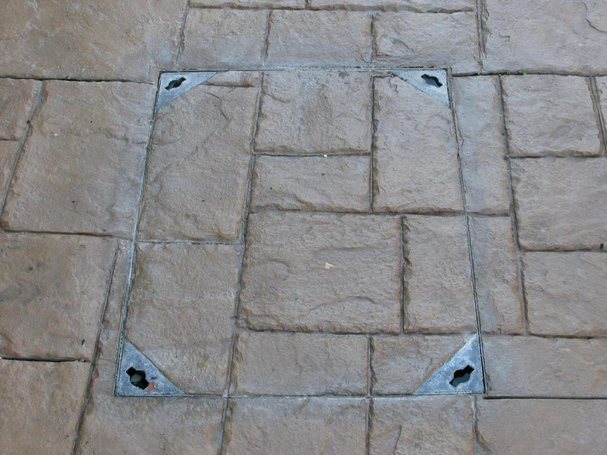 Drainage and other features can be blended in as per this recessed tray heavy duty manhole cover on a driveway.