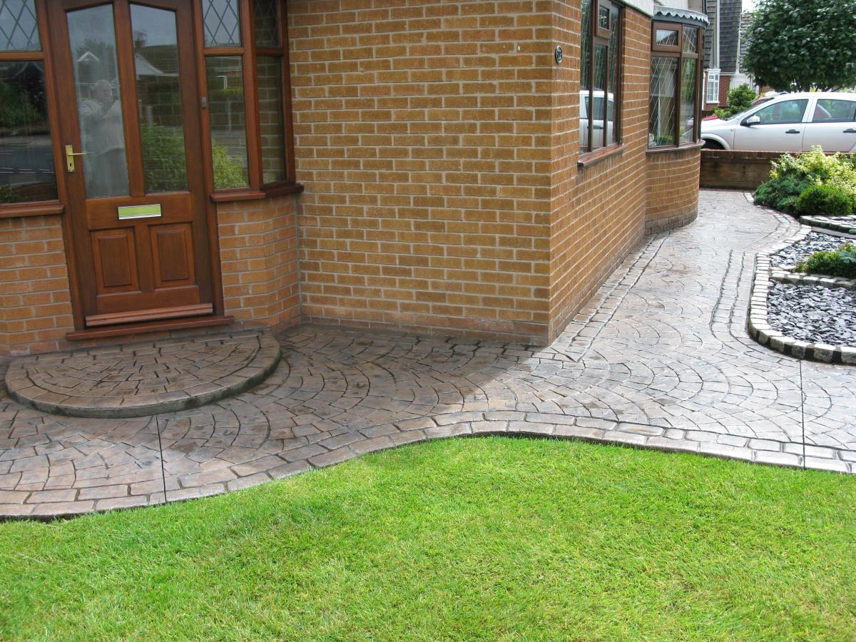 Toffee Coloured Concrete Garden Path Textured With European Fan And Edged  With Mews Cobblestone Laid At