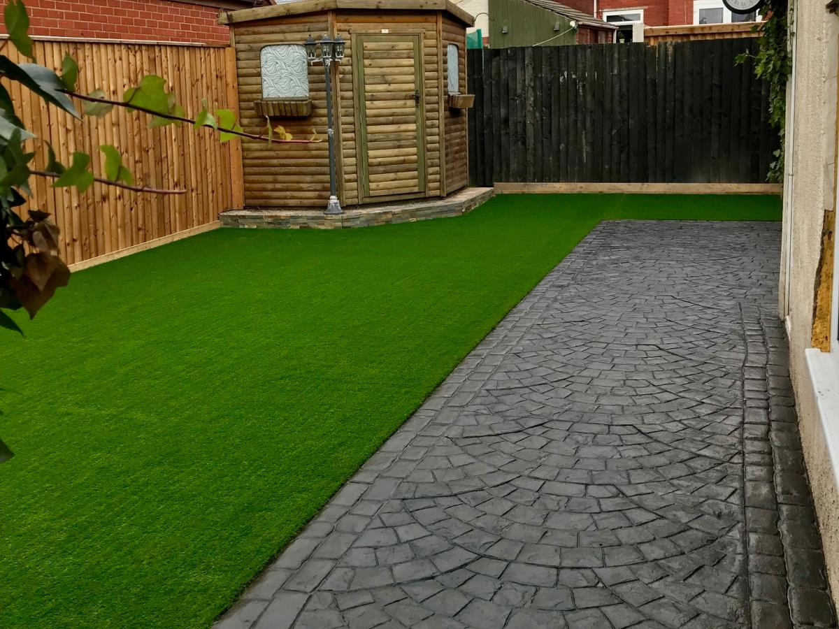 Artificial turf laid in the rear garden of a Poulton-le-Fylde property.