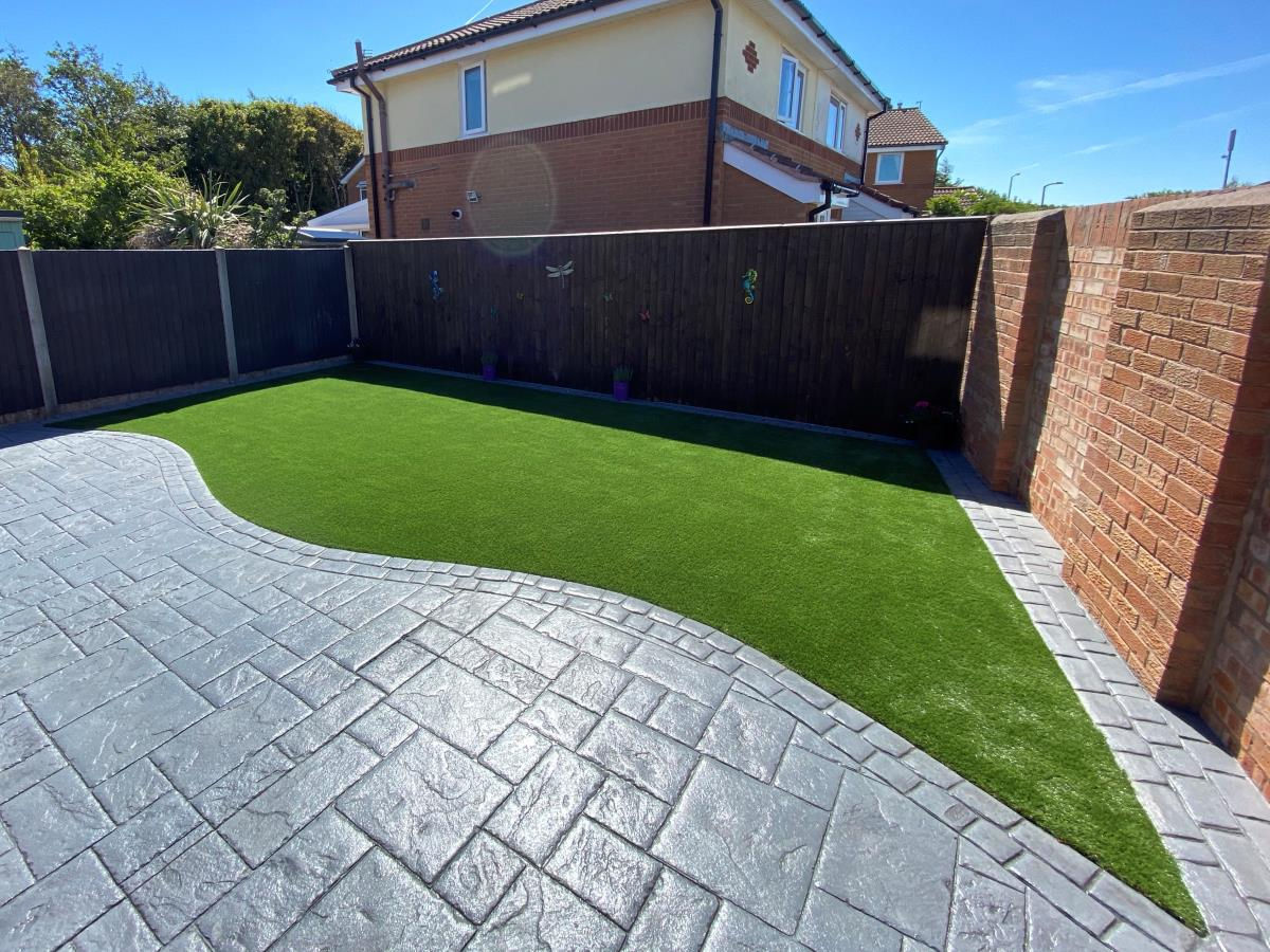 Luxurious fake grass lawn laid in a Thornton-Cleveleys back garden.