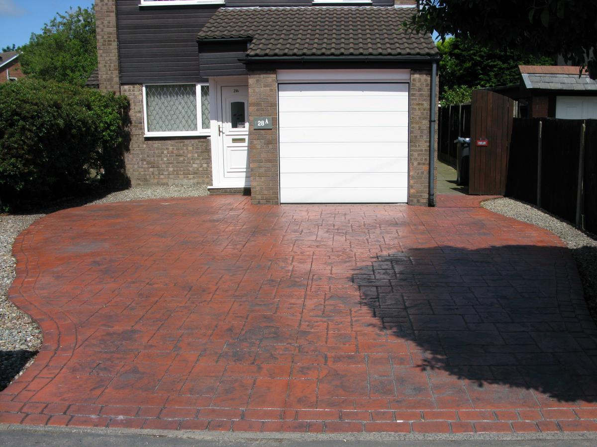 Sculpted pattern imprinted driveway in ashlar slate style in striking colour for a Carleton home, near Poulton-le-Fylde.