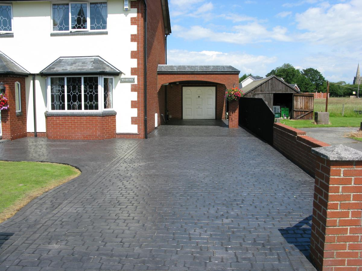 Concrete driveway in mews cobblestone style with gloss finish created for customer in Hambleton, Over Wyre.