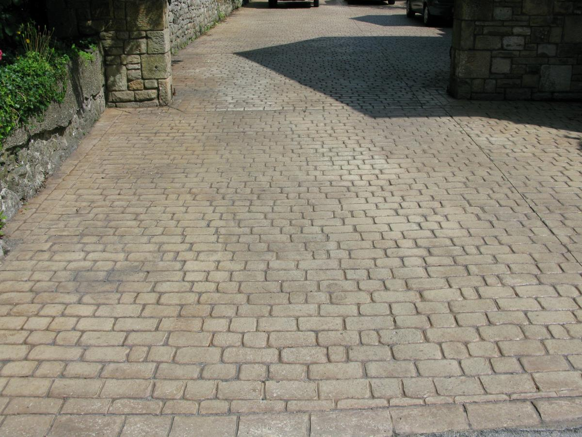 Mews cobblestone pattern imprinted driveway coloured country sandstone with a matt finish for a Lancaster property.