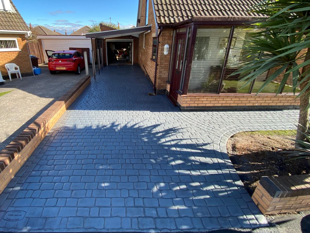 Pattern imprinted concrete driveway and path installed to a property in Lytham St Annes in a platinum silver mews cobblestone style.