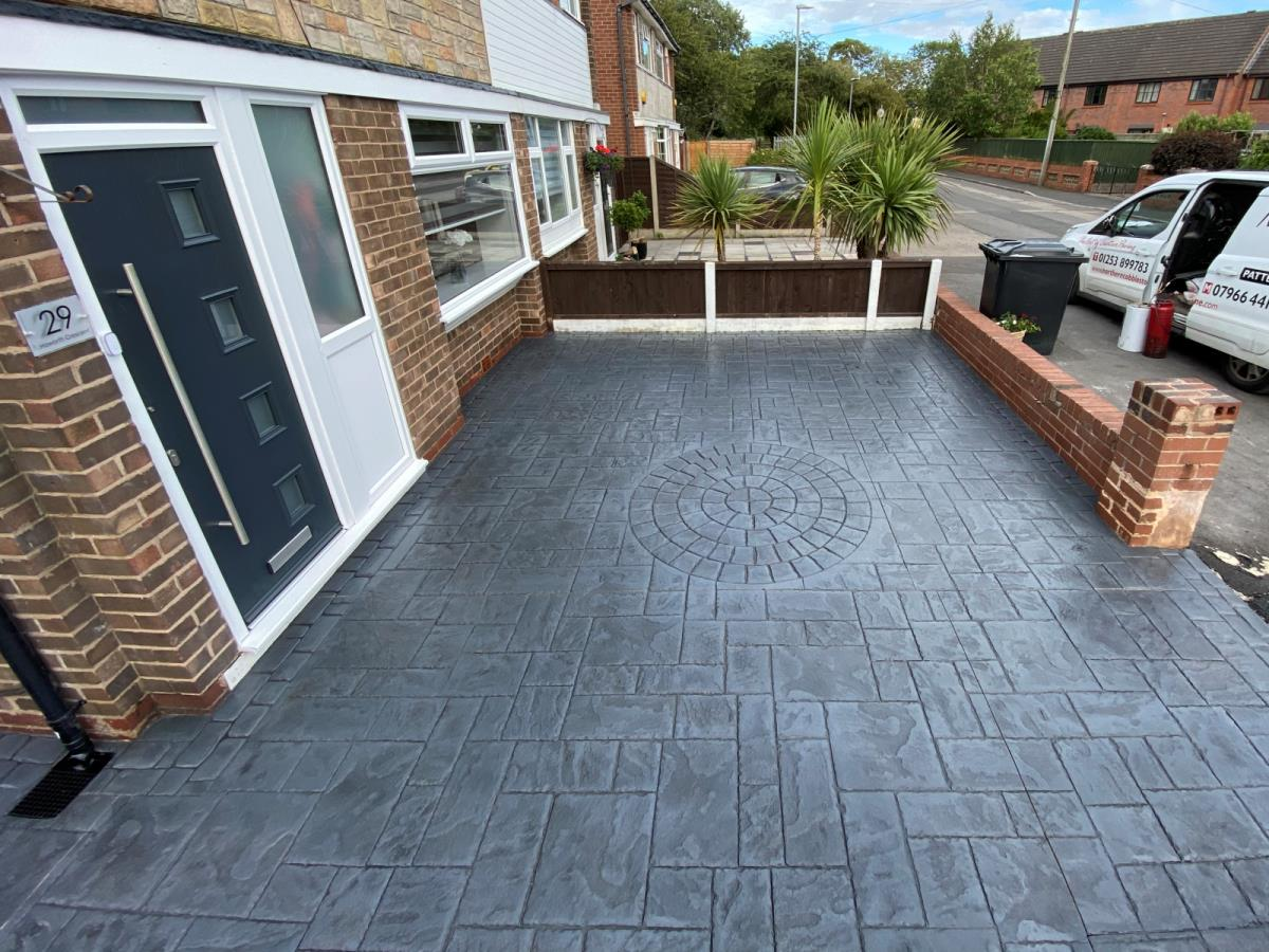 Stamped concrete to this Poulton-le-Fylde front garden offers attractive, hard wearing, additional off road parking space.