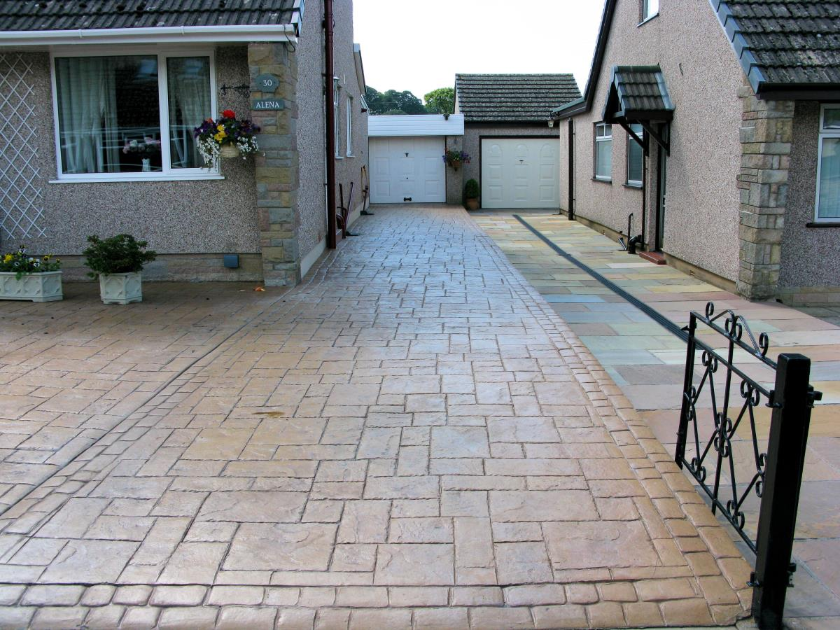 Pattern imprinted driveway textured in ashlar slate and coloured in country sandstone for bungalow in St Annes-on-Sea.