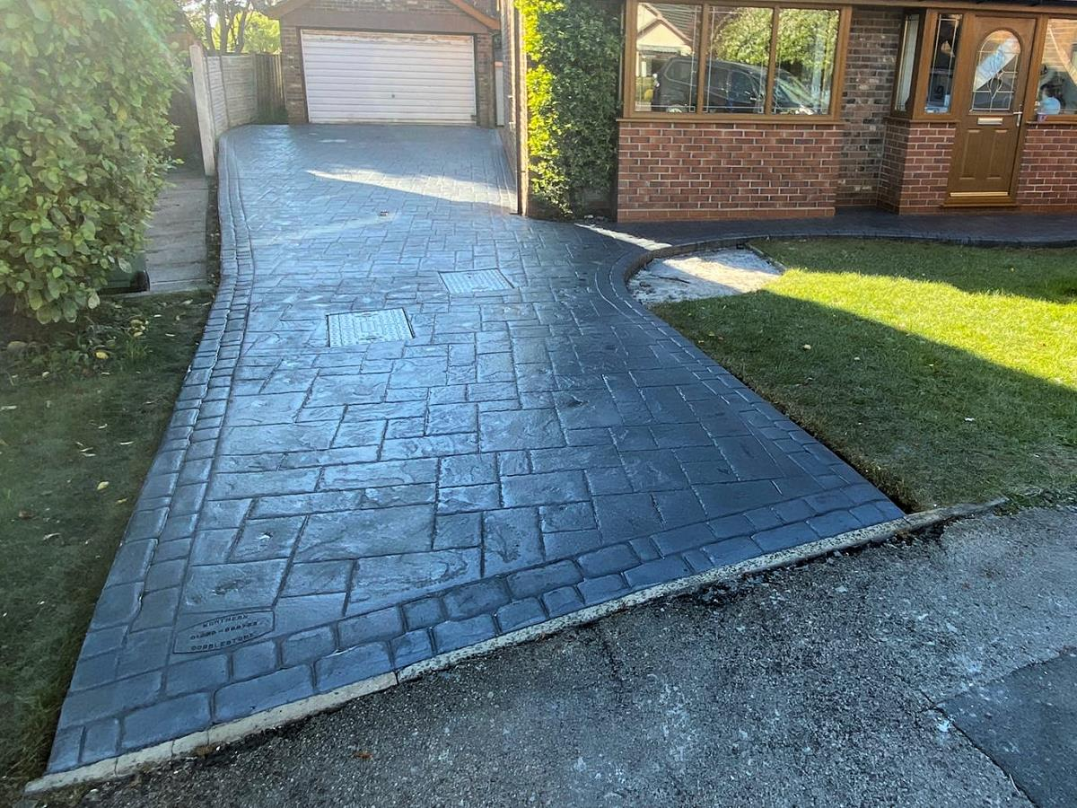 French grey imprinted concrete driveway and path to front door in ashlar slate pattern for Thornton Cleveleys home.