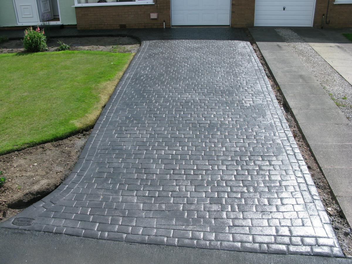 Mews cobblestone effect stamped concrete driveway installed for a Leyland customer.