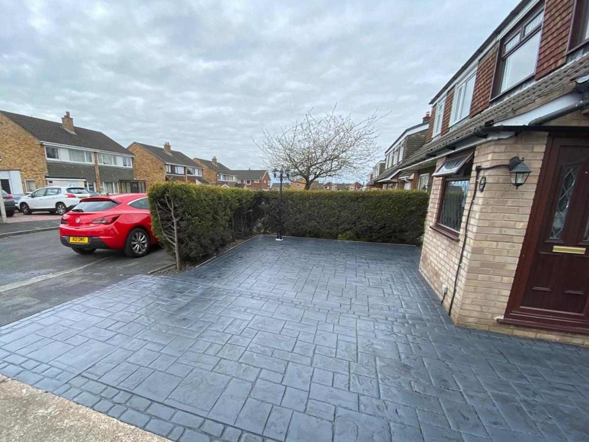 French grey pattern imprinted driveway and additional off-street parking to the front for a  Kirkham customer.