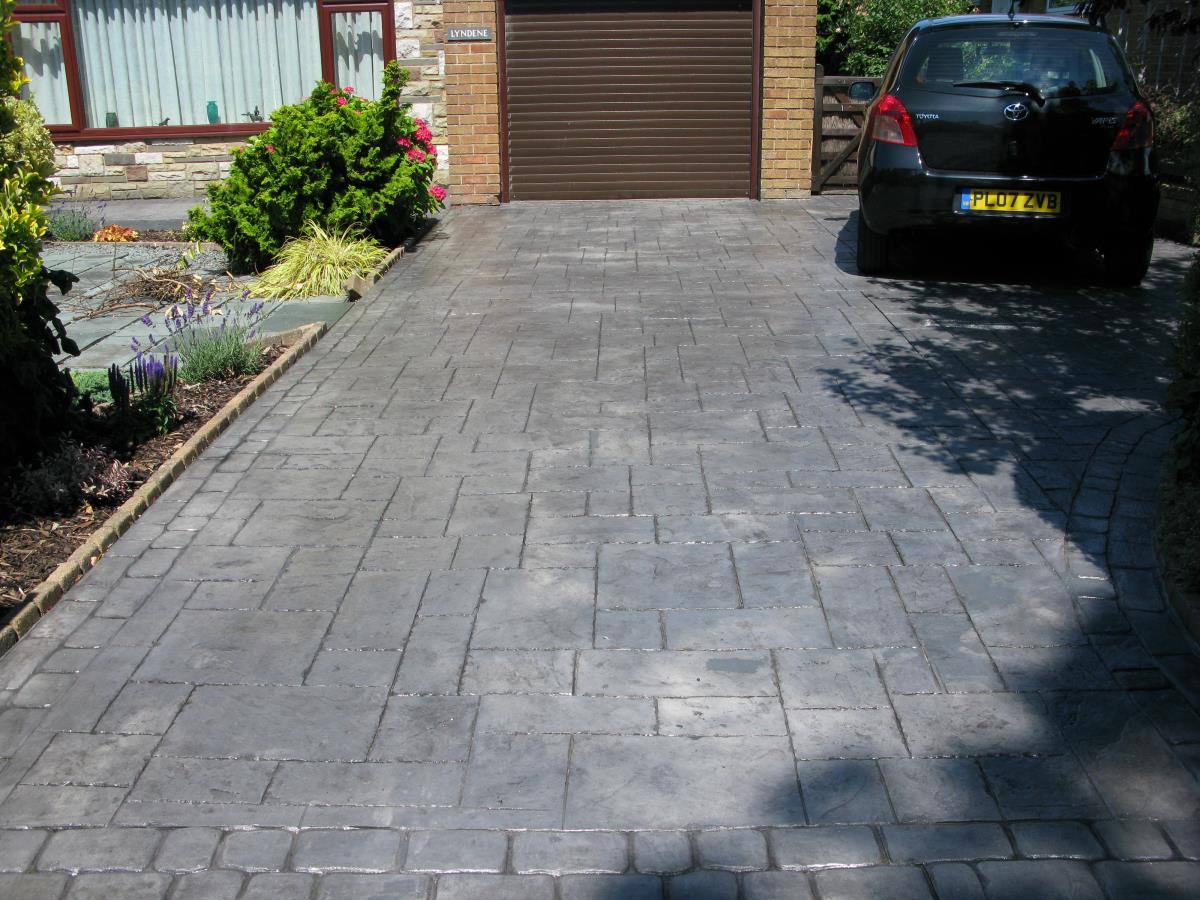 Patterned concrete in a silver grey ashlar slate style installed to Kirkham driveway.