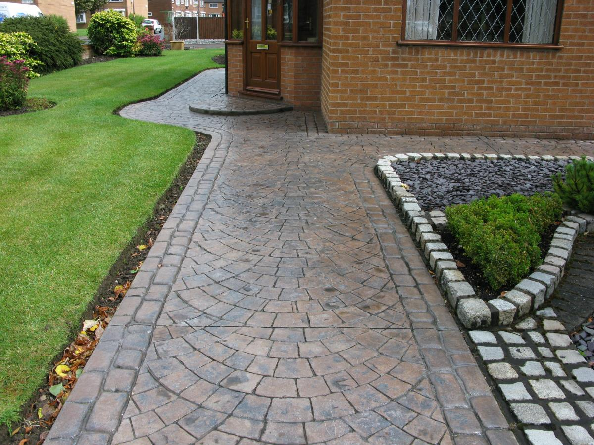 Patterned imprinted concrete path in toffee coloured European fan, edged with mews cobblestone for a house in Bispham, Blackpool.