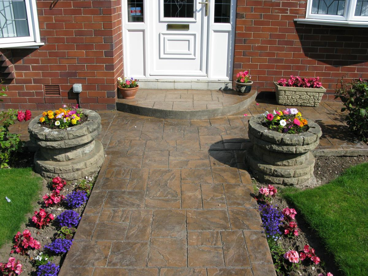 Pattern imprinted concrete path and quadrant step in toffee coloured ashlar slate style installed to a garden in Poulton-le-Fylde.