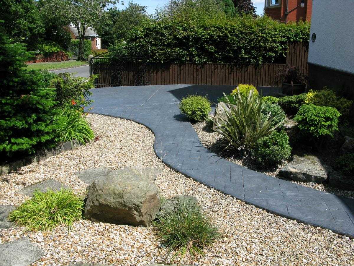 Wavy ashlar slate effect pattern imprinted path in the front garden of a St Annes-on-Sea property.