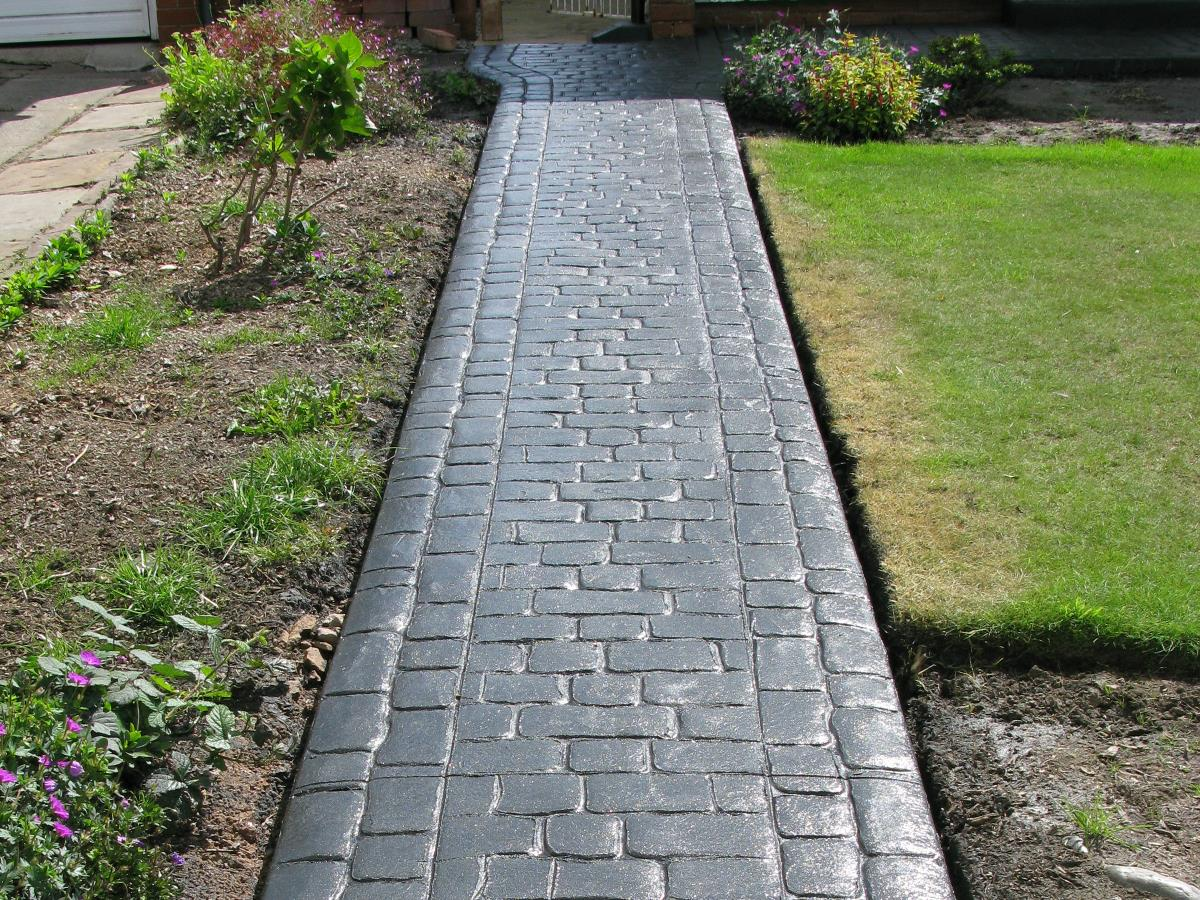 Stamped concrete path in glossy mews cobblestone style for a Thornton Cleveleys front garden.