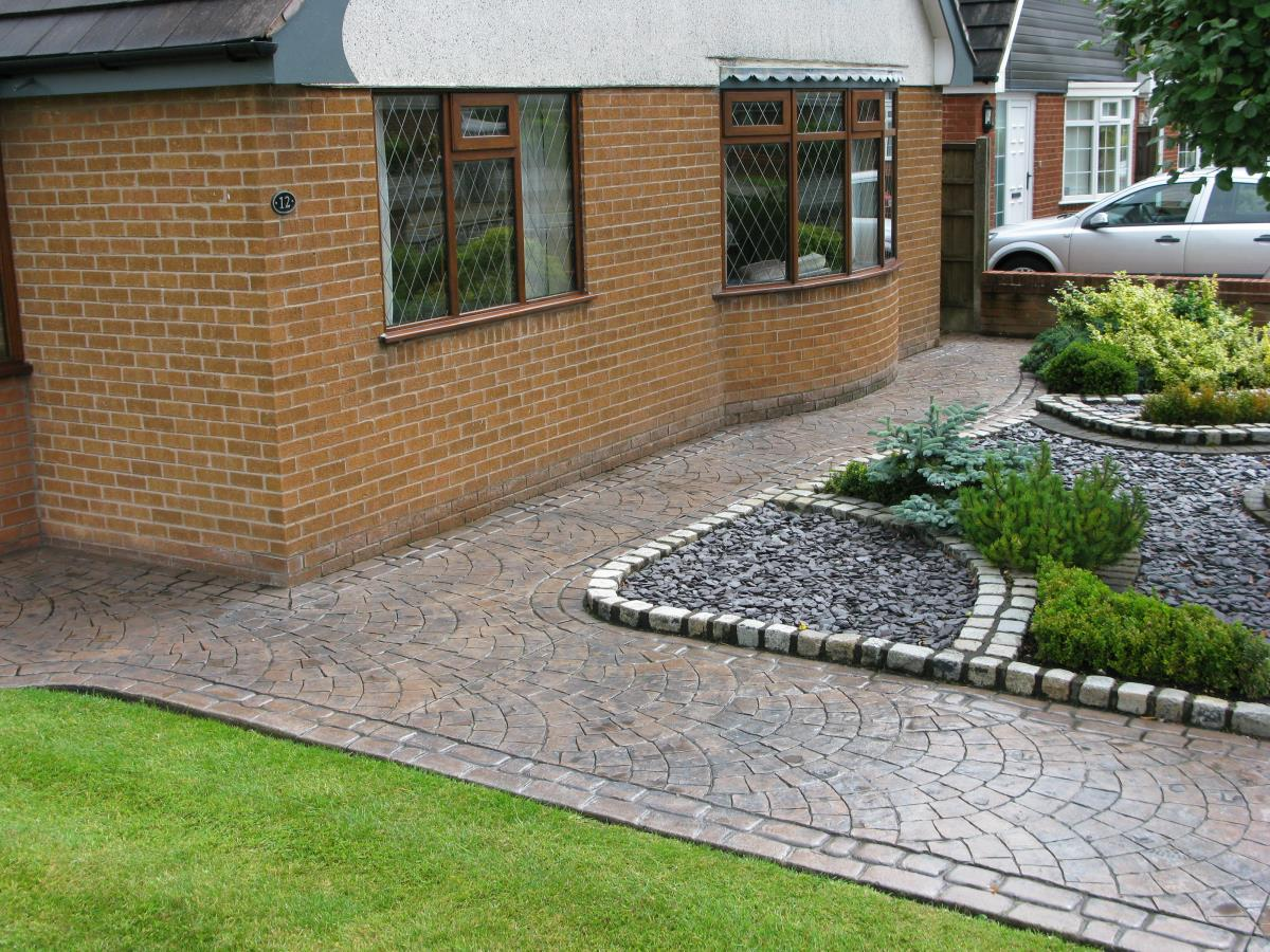 Toffee coloured, European fan, patterned imprinted concrete path, edged with mews cobblestone for a house in Kirkham.