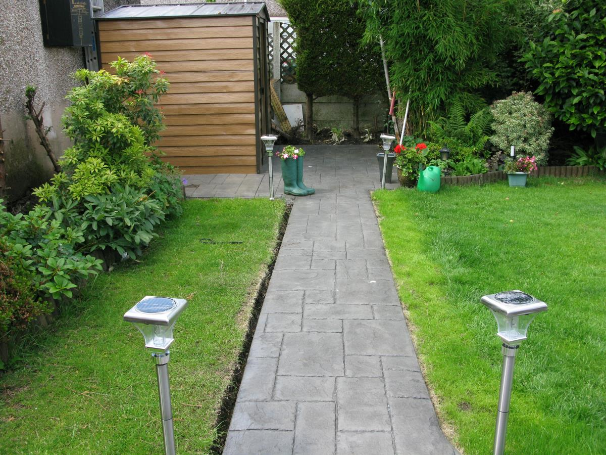 Satin finished rear garden concrete path and shed base stamped with ashlar slate and mews cobble edging in Poulton-le-Fylde.