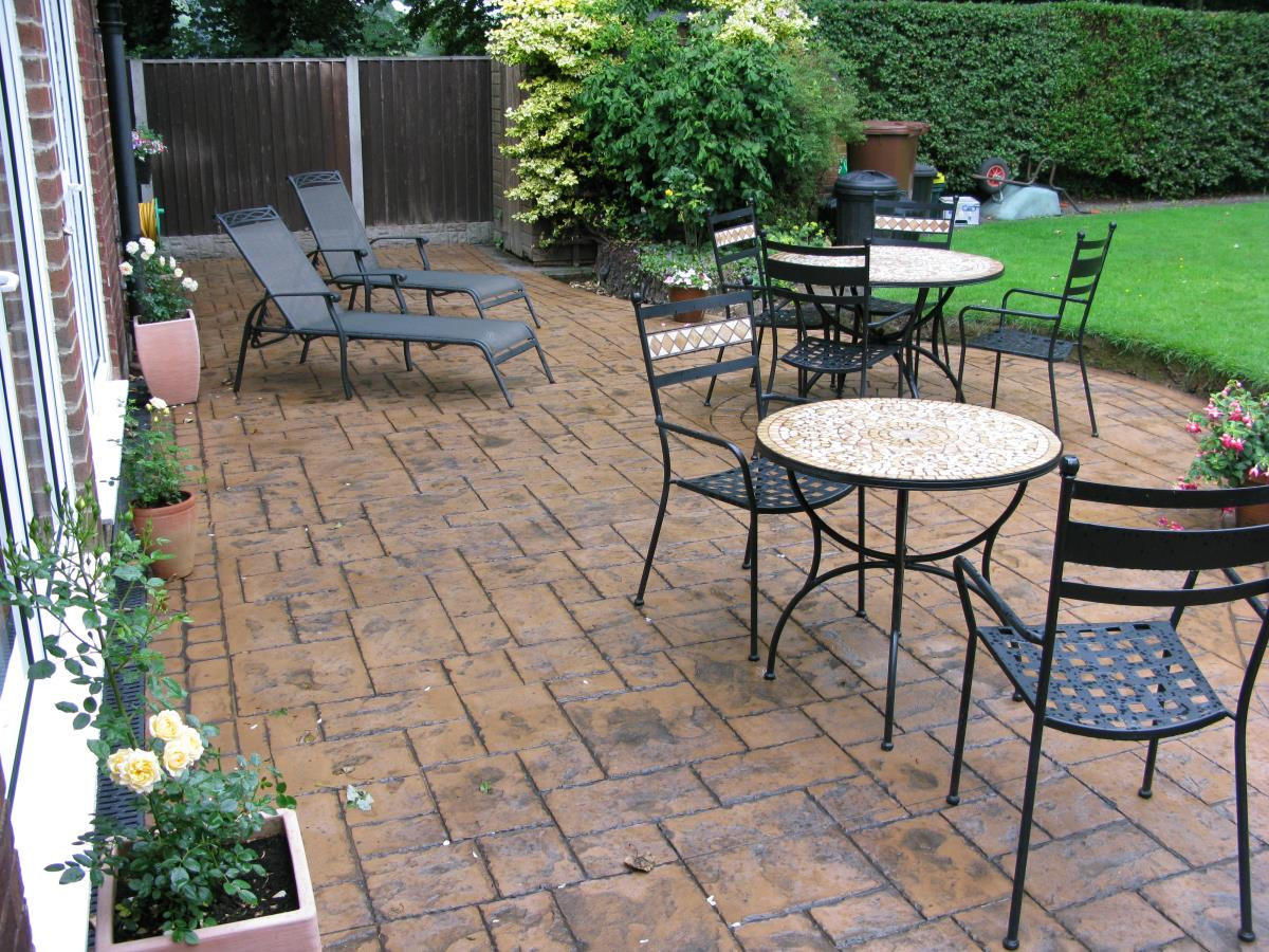 Decorative concrete patio in ashlar slate, installed to garden in Chorley, near Preston.