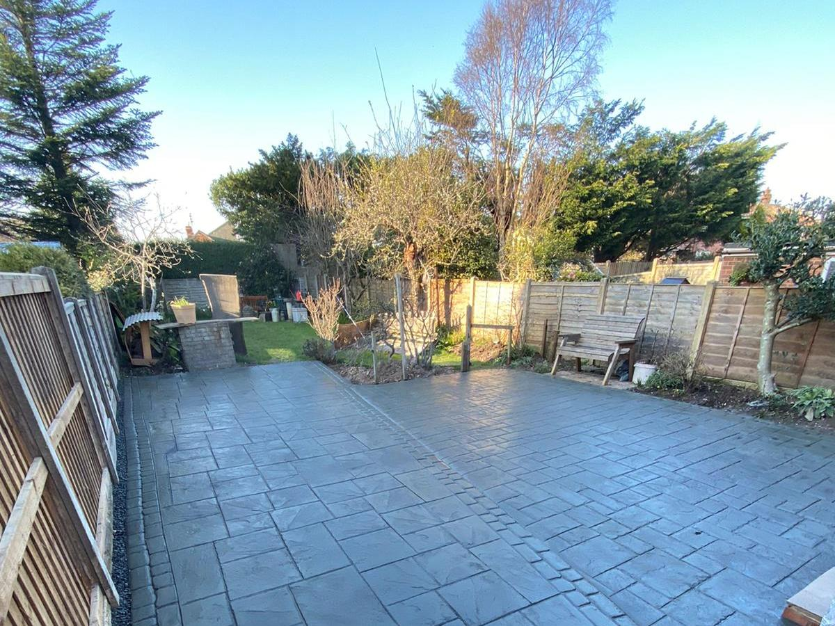 Generous sized patio and extended off-street parking in imprinted concrete for a Poulton-le-Fylde customer.