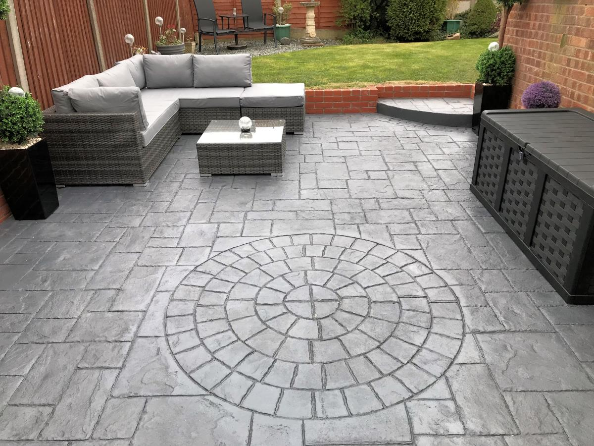 Stunning pattern imprinted concrete patio area installed to a Thornton-Cleveleys rear garden.