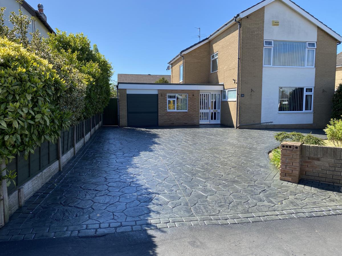 Refurbishment on pattern imprinted driveway including a jet wash and re-seal.