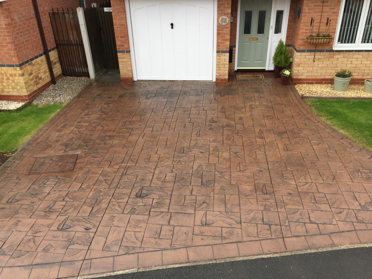 Newly resealed stamped concrete driveway looking like new after 15 years of Poulton-le-Fylde weather.