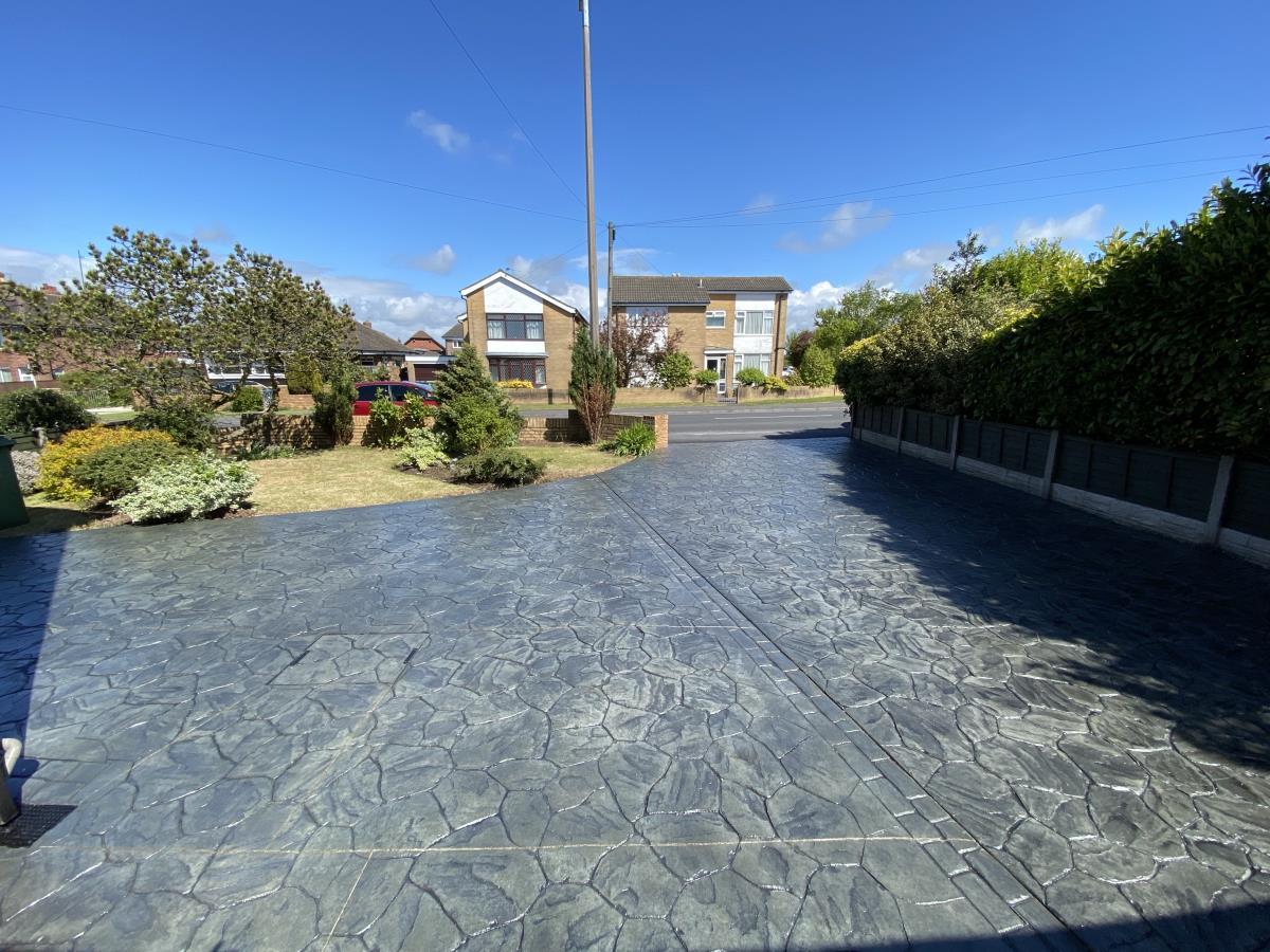 Refurbishment to a pattern imprinted driveway in Fleetwood, including a jet wash and re-seal.