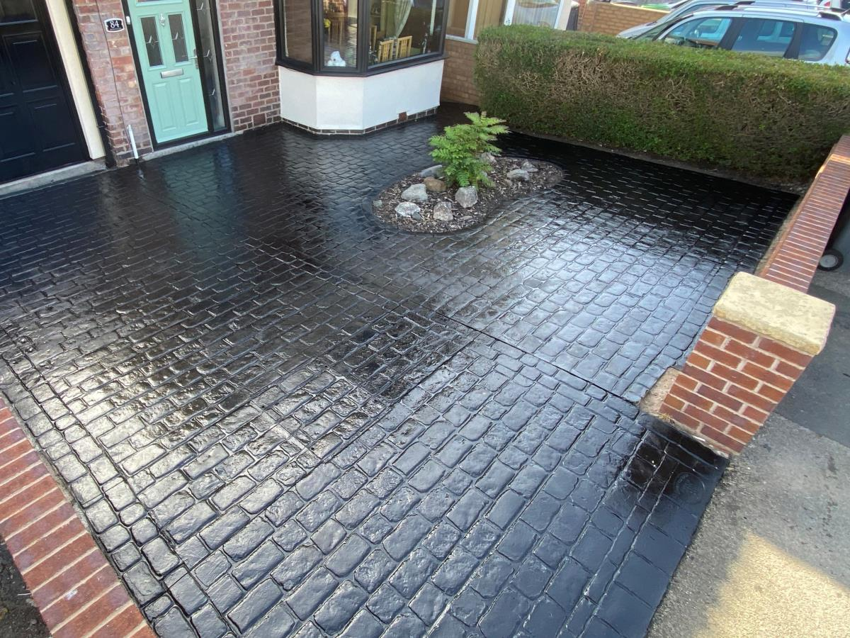 A ten year old driveway re-coloured and re-sealed in charcoal black in Over Wyre area.