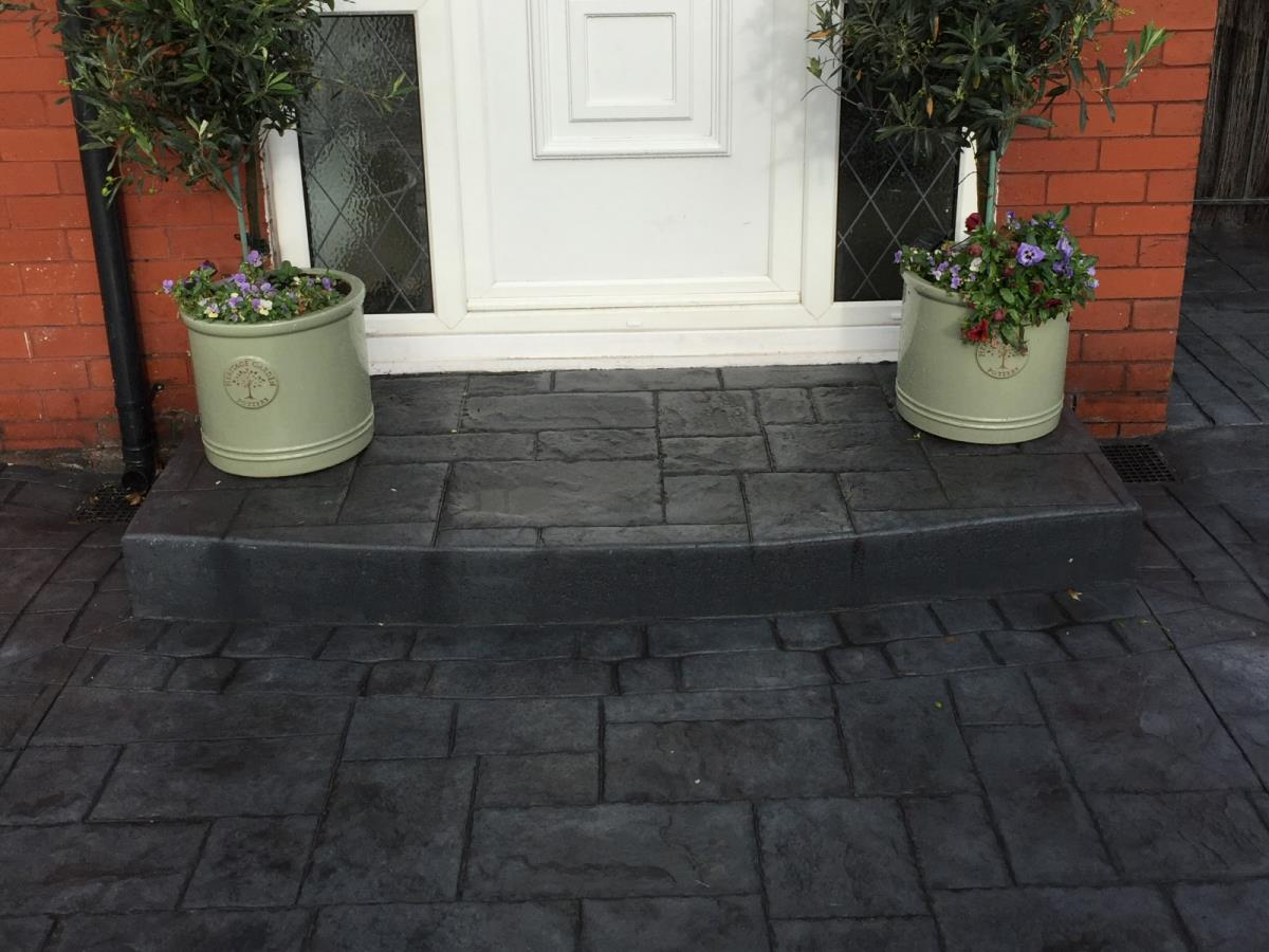 Pattern imprinted concrete steps in slate blue for Thornton-Cleveleys home.
