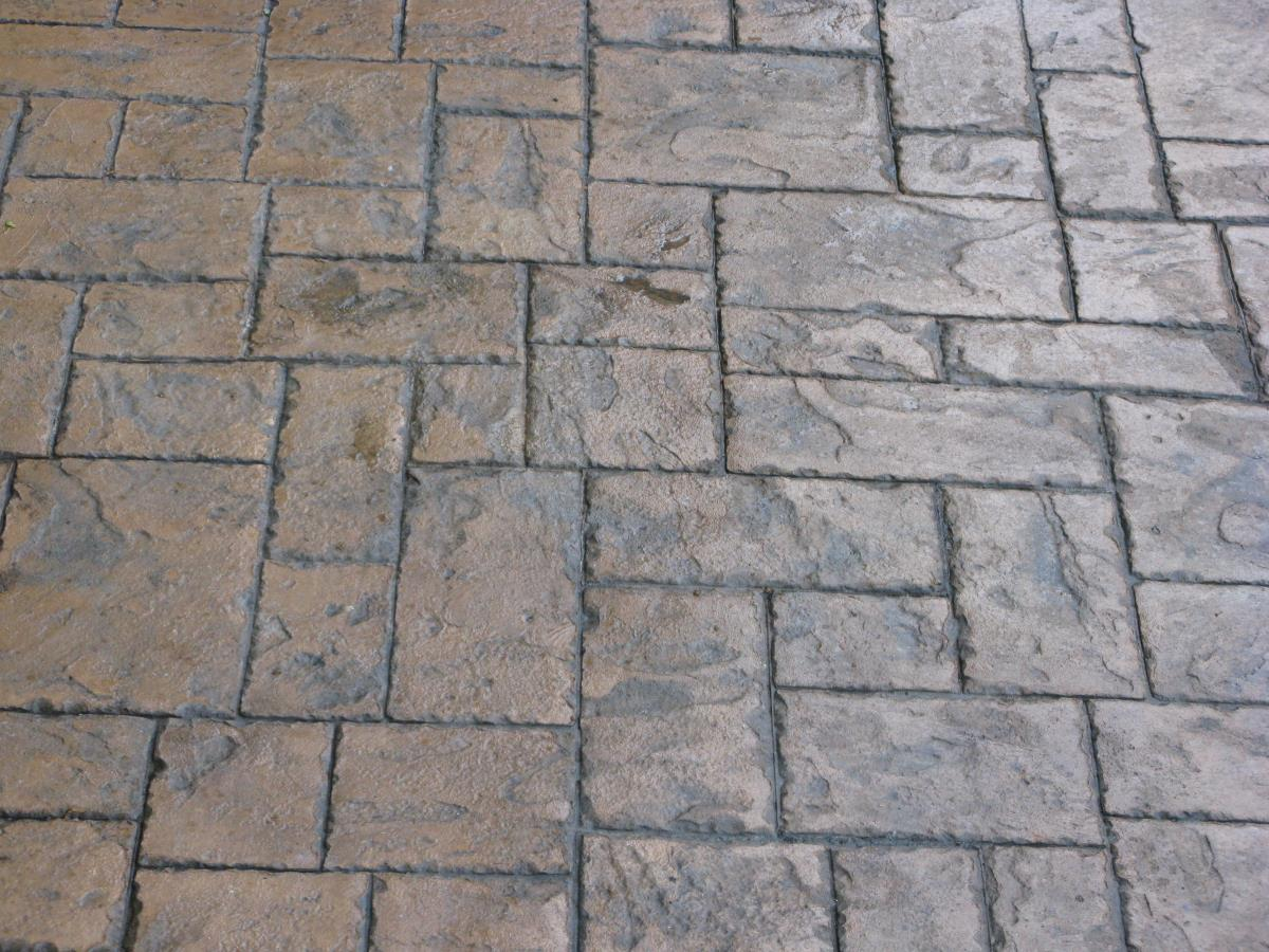 Patterned imprinted concrete in ashlar slate makes a great alternative to block paving.