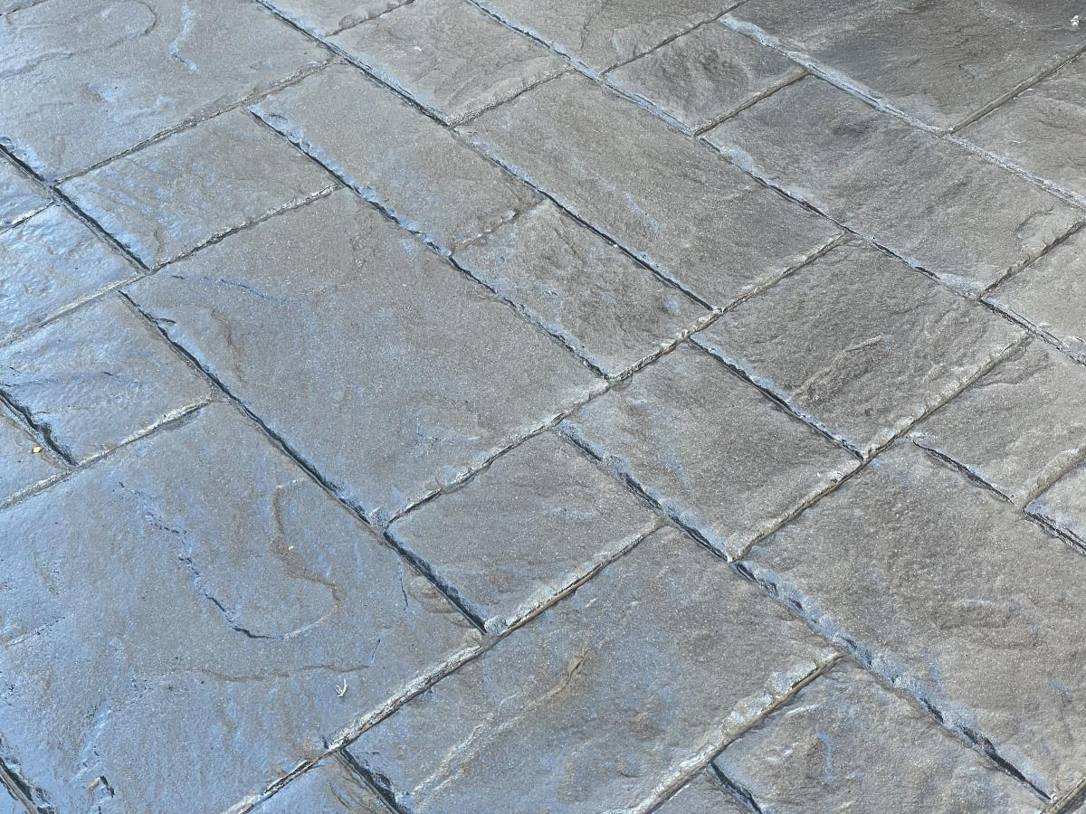 Detail of French grey ashlar slate style. As attractive as paving, but without the maintenance.