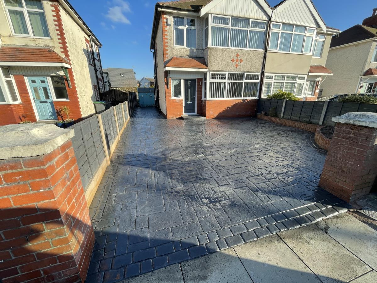 Ashlar slate styled stamped concrete driveway providing ample off road parking in Anchorsholme, Cleveleys.