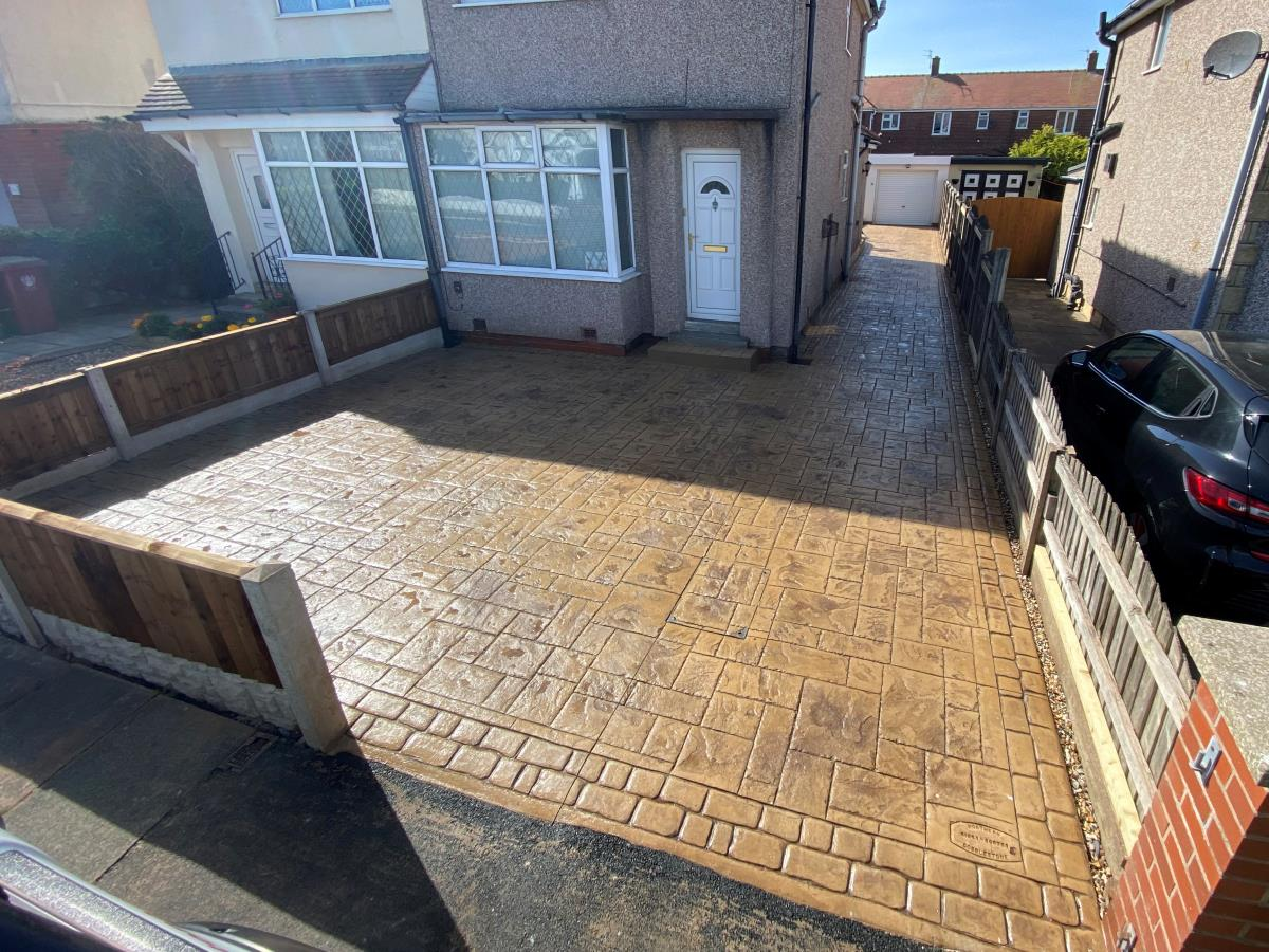 An ashlar slate style stamped concrete driveway installation for a Bispham, Blackpool property in Arizona tan colour.