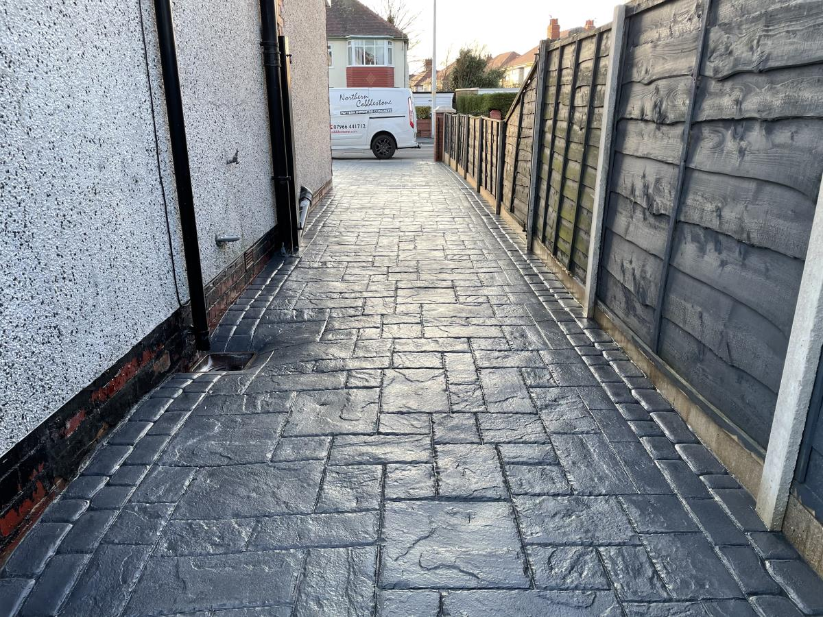 An excellent example of the light showing off this French grey stamped concrete driveway at a Cleveleys property.