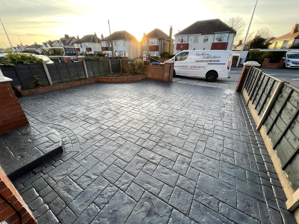 Beautiful sunset photo of a stamped concrete driveway installed to a Cleveleys home.