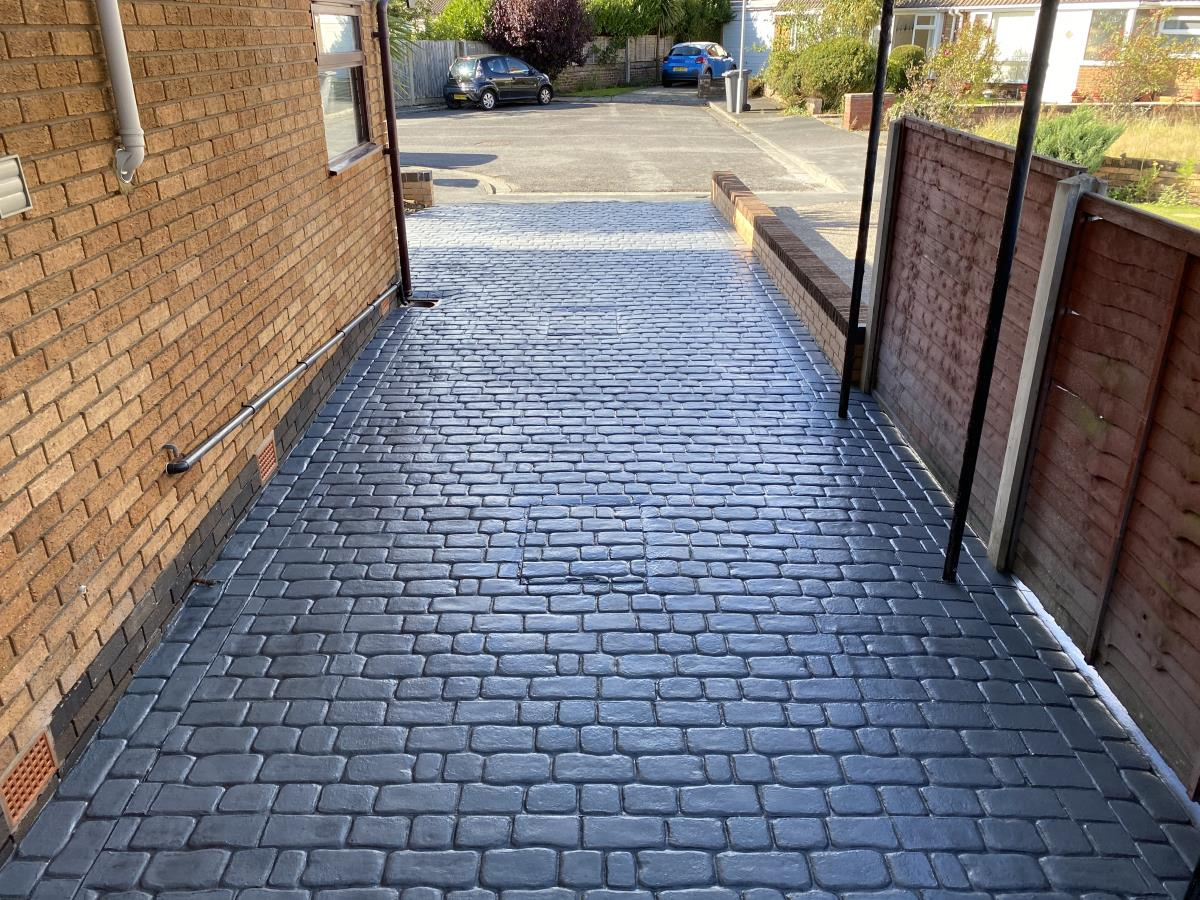 Mews cobblestone styled stamped concrete driveway installed down the side of a house in Lytham St Annes.