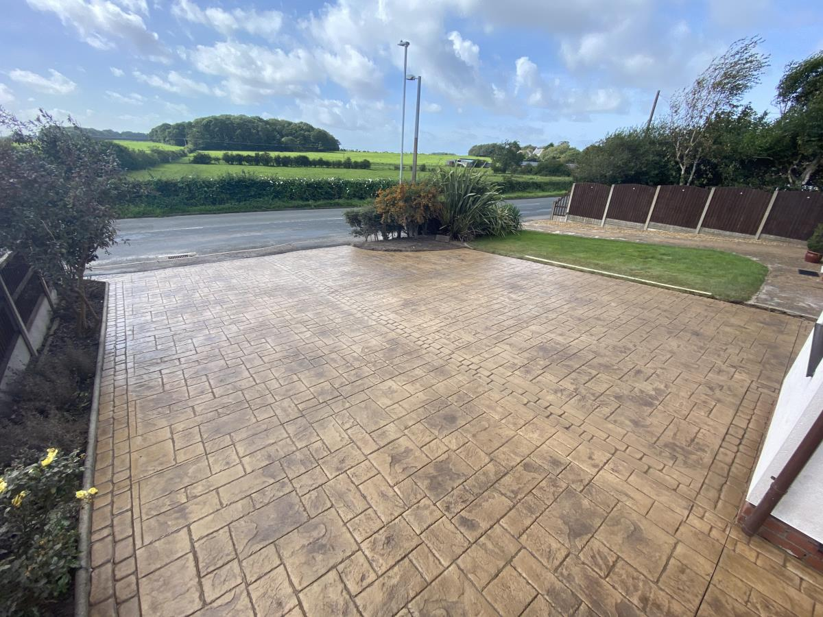 Stunning stamped concrete driveway in Arizona tan with a stunning view for a property in Singleton, near Poulton.